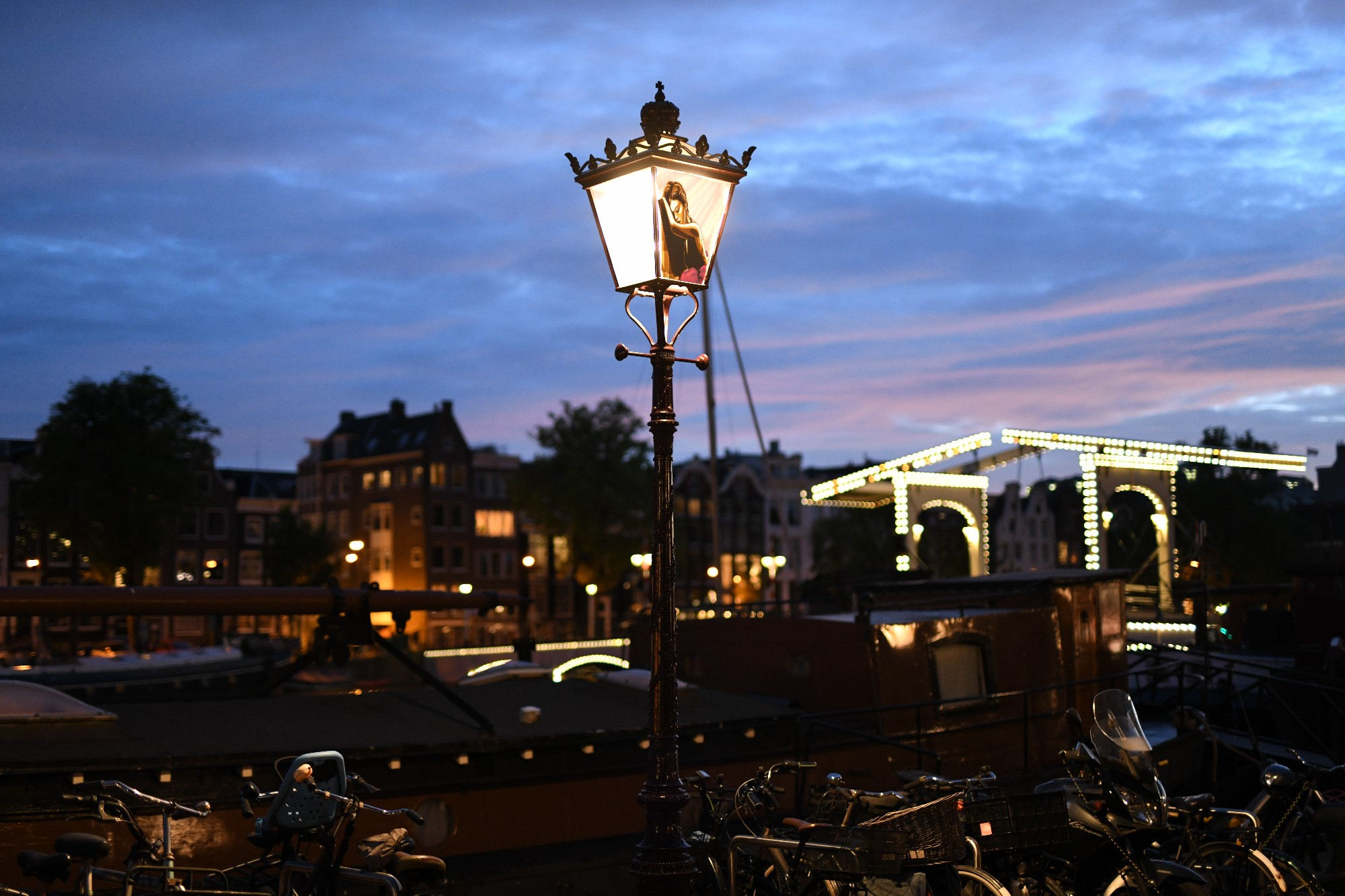 wide shot with Tape Art Sticker on street lamp in Amsterdam by artist Max Zorn