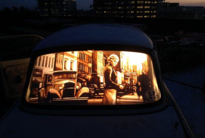 Tape artwork installed in a car by Max Zorn. Installation on roof top in Amsterdam. Kunst mit Klebeband installiert in ein Auto. Street art at night.